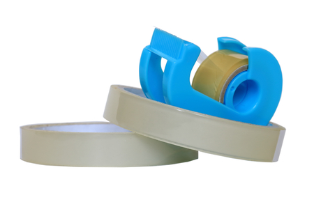 Adhesive tape. Tape dispenser. Stock Photo