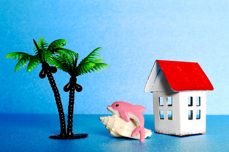 pink dolphin: The dolphin and the house and the palm tree. Stock Photo