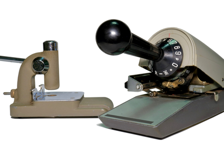 Check writer and Hole punch Check writer. Machine to print the currency in check. Hole punch. Hole puncher. Stock Photo