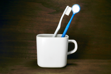 maru: Dental mirror and toothbrush and cup Stock Photo