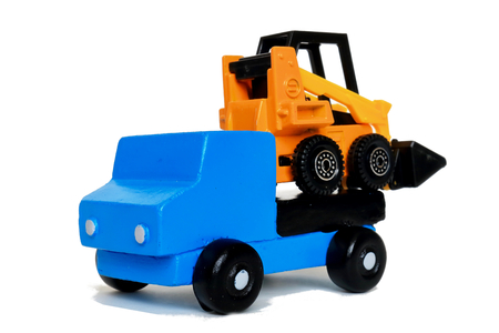 conveyance by land Land transportation of tire excavators on loaded car.