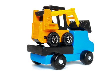 conveyance: conveyance by land Land transportation of tire excavators on loaded car.
