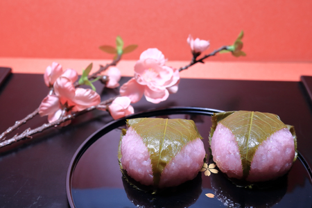 Bean paste rice cake wrapped in a cherry leaf