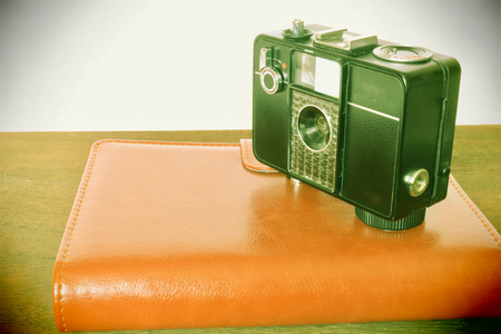 handbooks: Toy camera wind processing with film camera and notebook