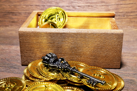 Toy gold coins and wood box