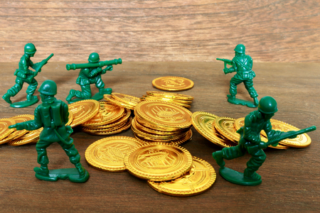 Toy gold coins and soldier. Mass production of 100 yen shop.