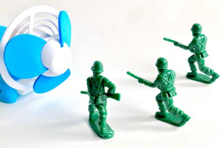 Portable fan and soldier Reklamní fotografie