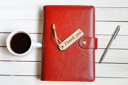 コーヒーやノートブック、自己になりましたタグthank you