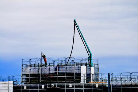 Concrete pumping at construction site