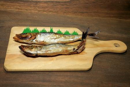 Dried sardines on a chopping board