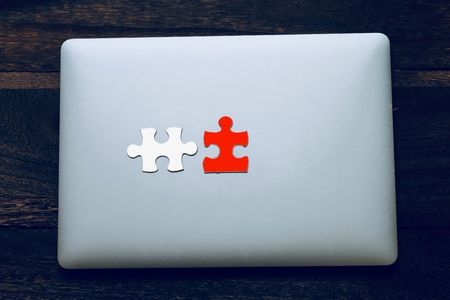 Laptops and puzzles Stok Fotoğraf