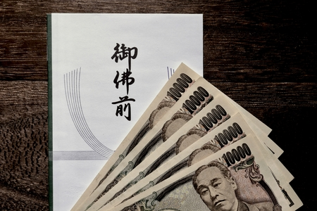Gift wrapping paper ( condolence gift  and yen currency on wooden table
