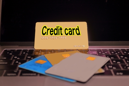 Credit card and laptop Stock Photo