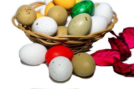 Easter Eggs in basket on white
