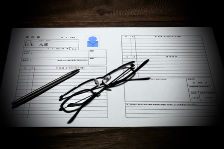 Resume with glasses and pen