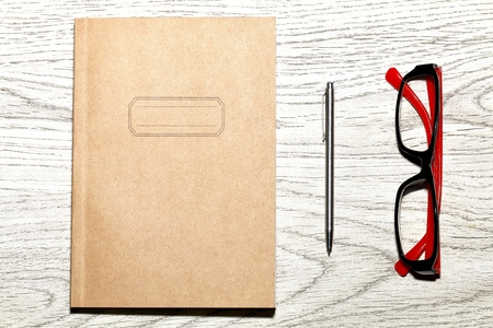 Notebook and pen and glasses