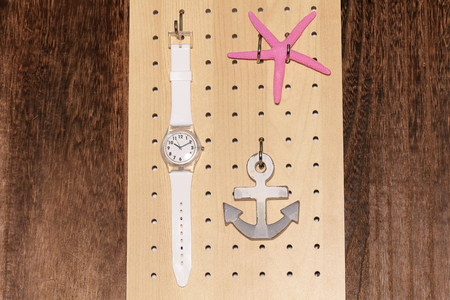 Perforated board and clock