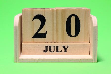 20 July on Wooden Standard-Bild
