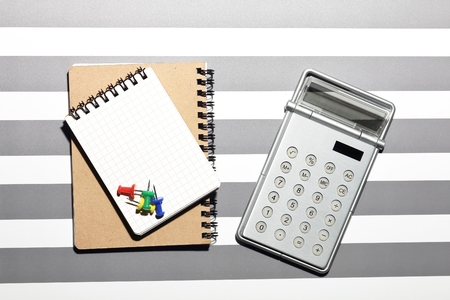 Calculator and book background.