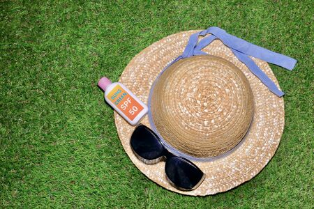 Straw Hat and Homemade sunscreen bottles