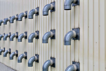 a wall lined with many ducts Wall with many ducts