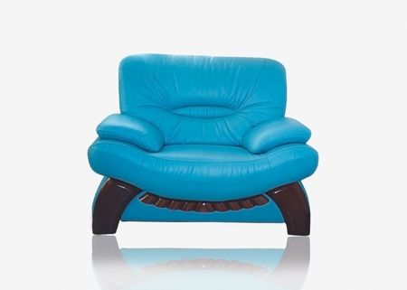 Stylish leather sofa of turquoise color with wooden legs Stock Photo - 2576996