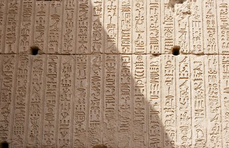Egyptian sings on the wall, background photo
