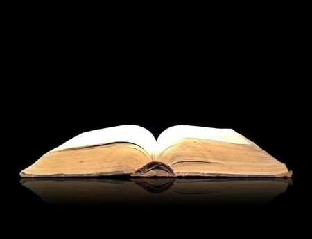 spells:  Open book magic on black
