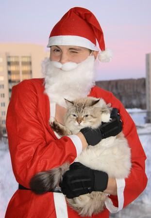 Santa with cat, christmas Stock Photo - 4079744