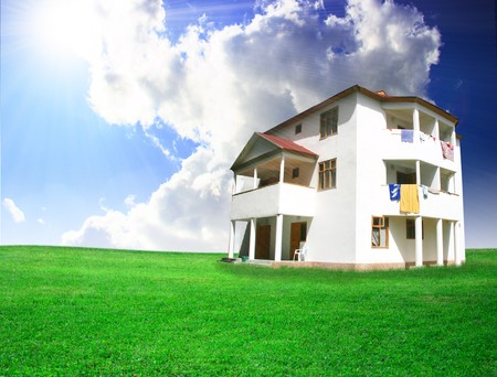 Nice house on green field Stock Photo - 4412841