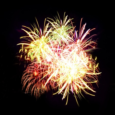 Firework streaks in night sky, celebration background photo