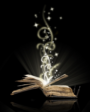 Opened book magic on black Stock Photo - 10846267