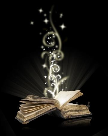 Magie du livre ouvert sur fond noir  Banque d'images