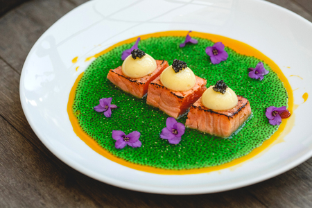 stereotypically: Grilled salmon and molecular caviar and flower
