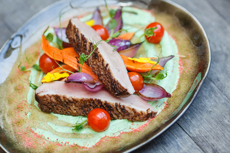 stereotypically: Duck fillet with vegetable