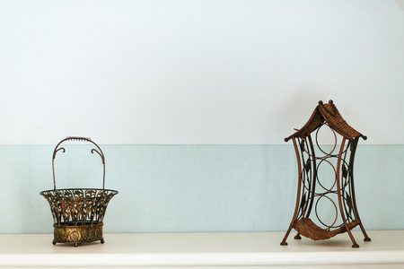 brassy: Vintage lantern and basket on the shelf