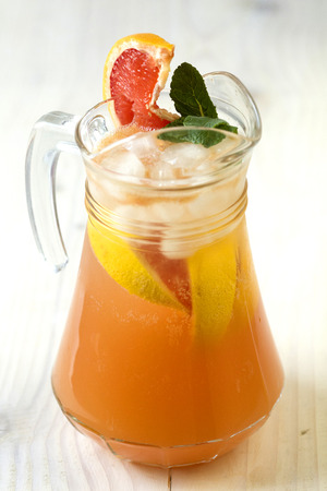 jag: Grapefruit lemonade in jag with ice Stock Photo