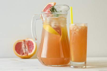 jag: Grapefruit lemonade in jag and colorful beverages in glass