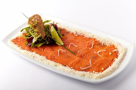 redfish: Fresh salmon with lemon on the white plate