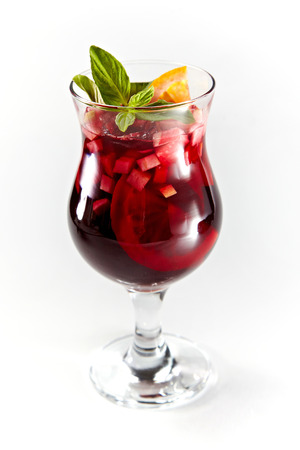 icecubes: Red cocktail with fruits in a glass isolated on a white background Stock Photo