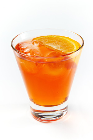 icecubes: Orange cocktail in a glass isolated on white background