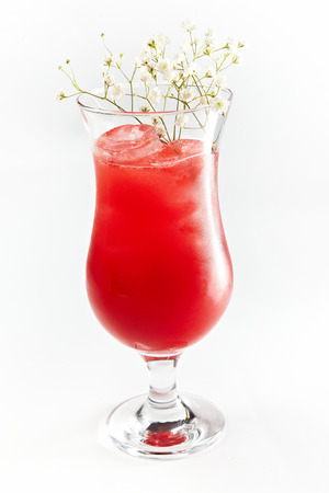 Red cocktail in a glass with black elder isolated on a white background Stock Photo