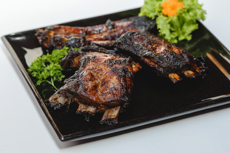 Roasted sliced ??barbecue pork ribs on white background for the menu