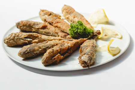 Fried fishes on white background for the menu Stock Photo