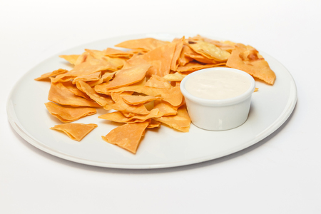 pita: Homemade pita chips made from pita bread with olive oil on white background