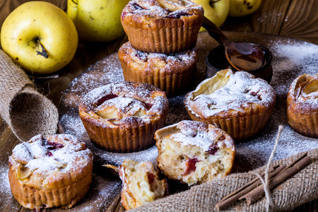 Apple muffins on wood background