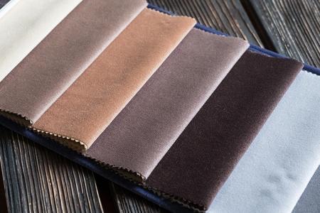 Color samples of a fabric on a wood background Reklamní fotografie