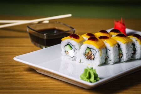 Plate of sushi on wood table