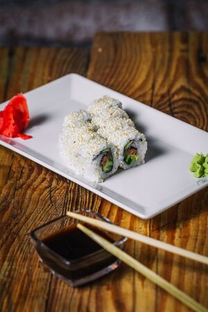Sushi rolls on wood background 写真素材