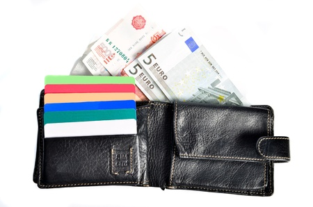 partmone with money and credit cards on a white background photo